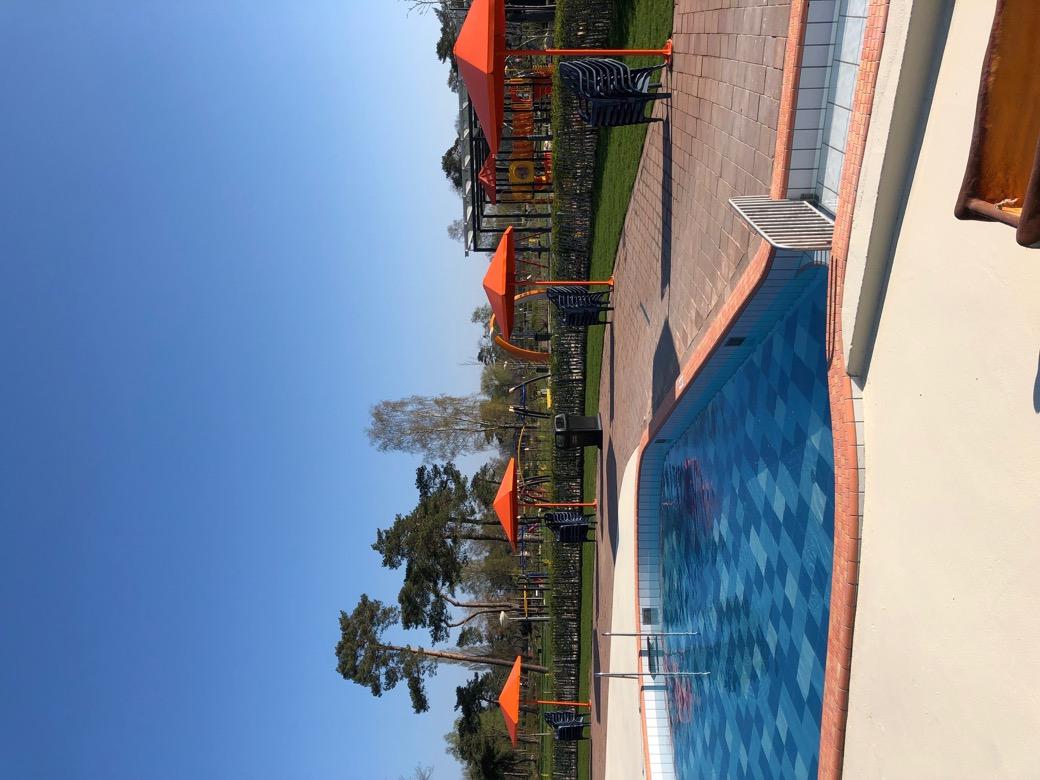 Four Seasons parasol voor aan het zwembad