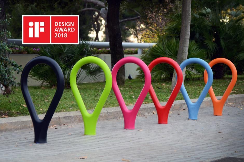 Loclock fietsbeugel fietsstandaard van beton met kunststof ronde buis beetje ovaal gevormd als een druppel in het roze groen zwart grijs wit paars rood geel blauw en grijs voor de openbare ruimte winkelgebieden kantoren bedrijven voor parkeren fiets